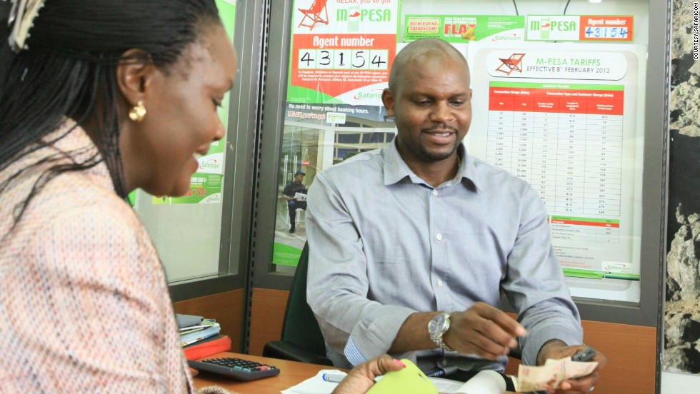 Kenya's M-Pesa pioneered mobile money transfers. Pictured, a Safaricom customer in Kenya uses the system to carry out a cell-phone banking transaction.