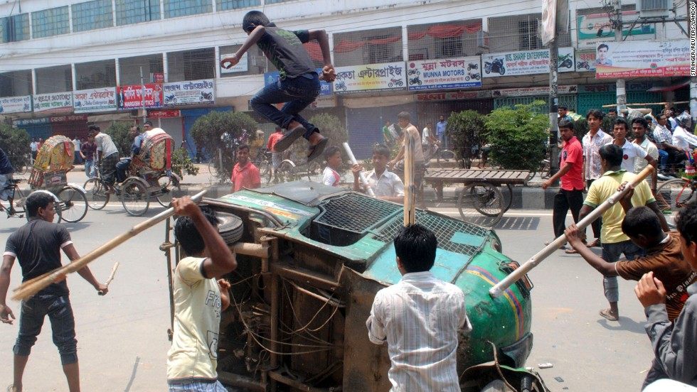 Garment workers block a street in Savar, demanding the arrest of the owner of the Rana Plaza building.