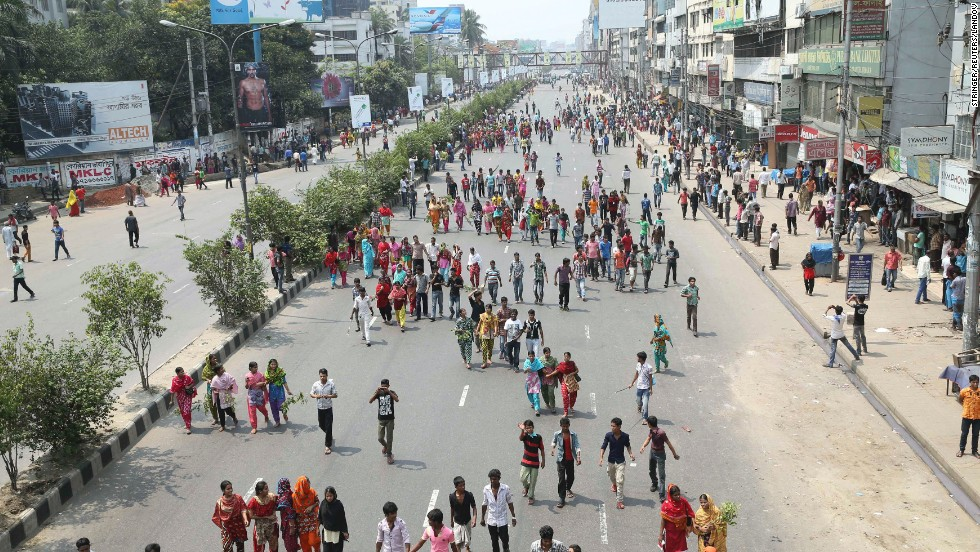 Garment workers block a street as they march to demand the arrest of the owner of the Rana Plaza building.