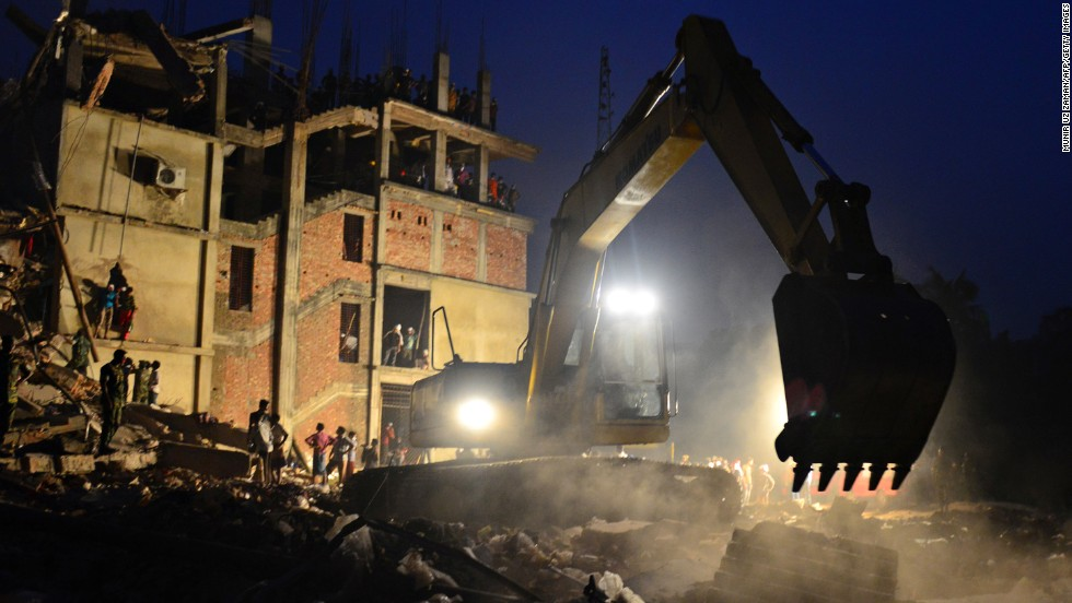 An excavator operated by the Bangladeshi Army removes debris on April 26.
