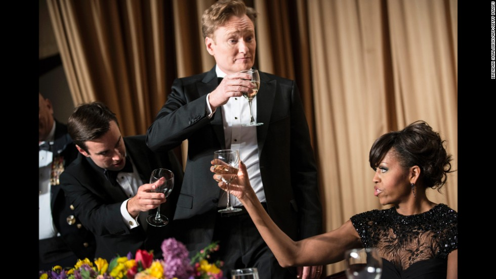Time magazine's Michael Scherer, left, Conan O'Brien and Michelle Obama raise their glasses with others for a toast.