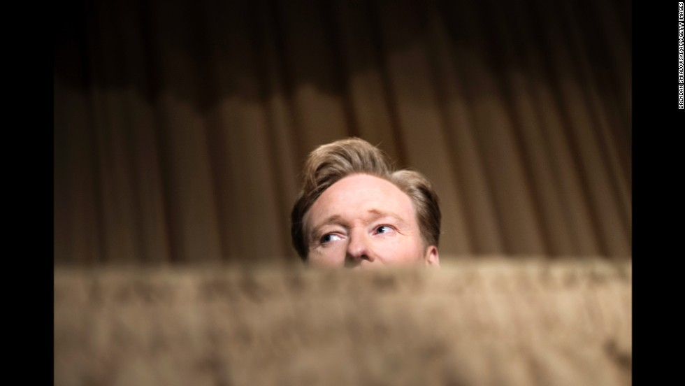 Conan O'Brien, and his hair, catch a glimpse of something during the proceedings.