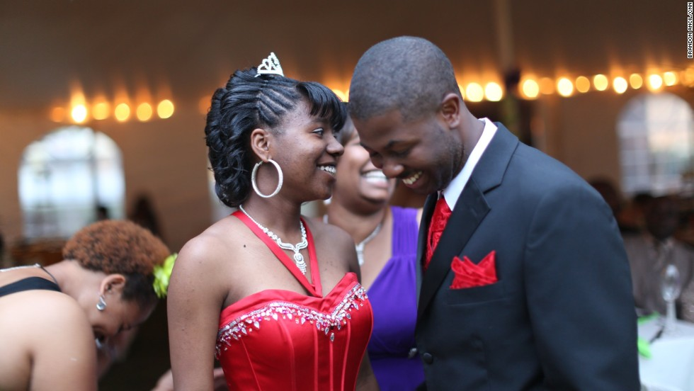 Mareshia Rucker, one of the 2013 prom organizers, wore a long, red gown and a small tiara in her hair. Her date, Mercer University student Arkel Bennett, wore a matching vest and tie. Mareshia's grandmother has sewn formal dresses for her to wear to the JROTC ball in the past. For the 2013 dance, her dress was donated.