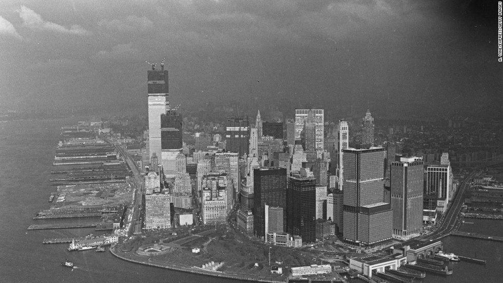 Storms hovered over the New York skyline as the twin towers of the World Trade Center continued to rise in 1971.