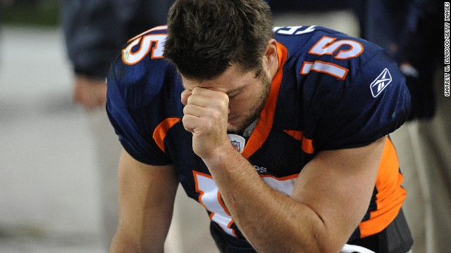 Tim Tebow prays during the final minute of the game against the New York Jets on 2011 in Denver, Colorado.