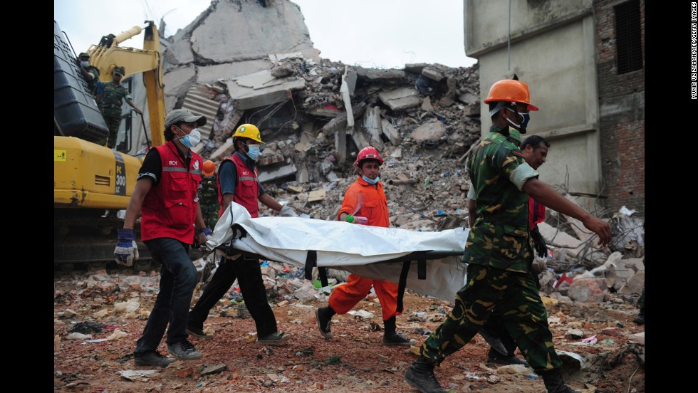 Bangladeshi troops carry the body of a garment worker out of the rubble of the collapsed Rana Plaza building in Savar on April 30.