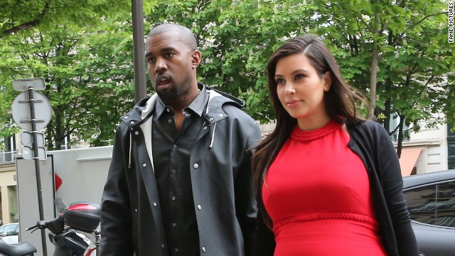 After a short Greece vacation with her family, pregnant reality star Kim Kardashian reunited with her rapper boyfriend Kanye West for some retail therapy in Paris, France on April 30, 2013. After shopping at luxurious stores Givenchy, Ferragamo, Hermes, Celine and Lanvin, the couple went to L'Avenue for lunch.