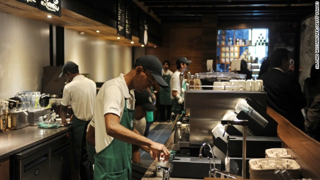 Baristas prepare drinks at the new Starbucks outlet in New Delhi, India, on February 6.
