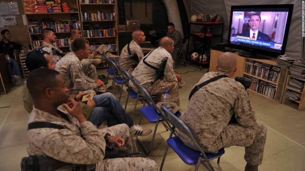 U.S. Marines watch the announcement of bin Laden's death at Camp Dwyer in Helmand Province, Afghanistan.