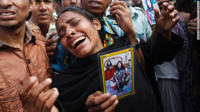 A woman mourns before a mass burial in Dhaka, Bangladesh, on Wednesday, May 1, seven days after the collapse of the Rana Plaza building in nearby town Savar.