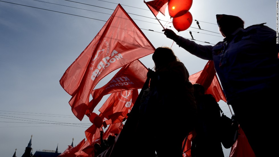Russian communist party activists carry red flags and banners during their traditional May Day rally in Moscow.
