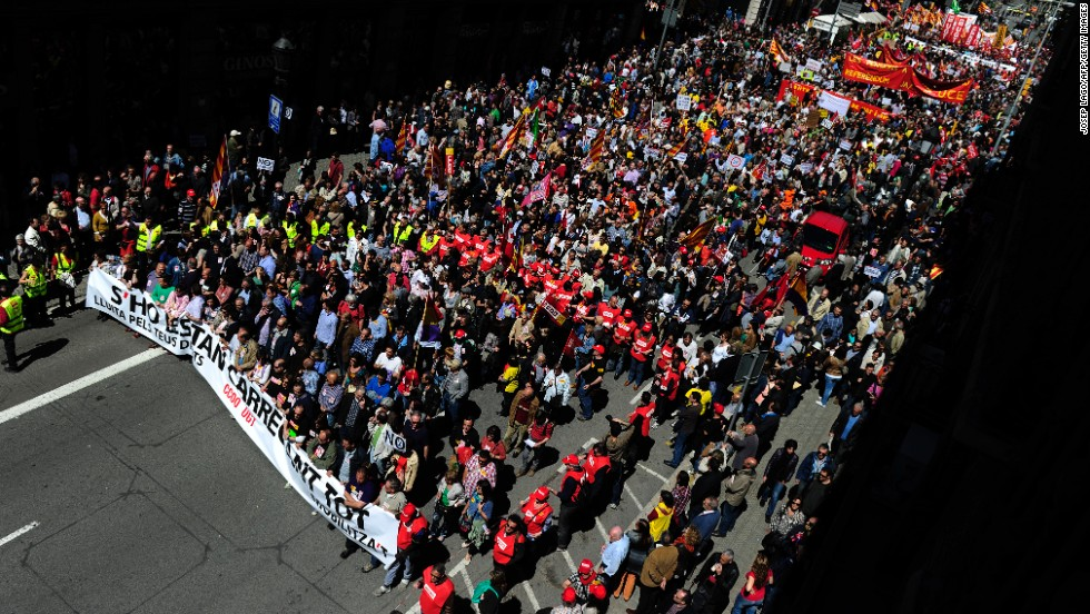 Demonstrators march against the Spanish government's austerity policies in Barcelona.