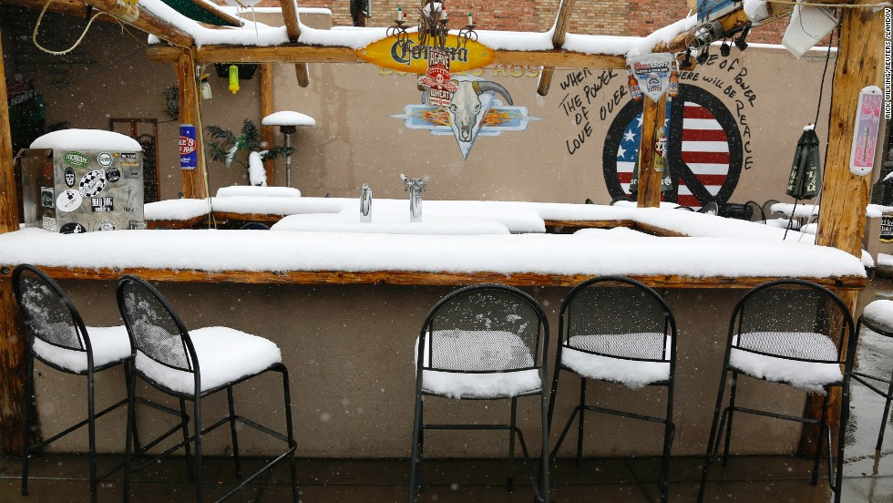 Snow covers an outdoor bar in downtown Golden, Colorado, after a spring storm dumped more than a foot of snow on Wednesday, May 1. In nearby Denver, the average date for the last snow of the season is April 26, but the record for the latest snowfall was set June 12, 1947, according to the National Weather Service.