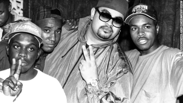 Rapper Heavy D (center, in shades) poses with members of the U.S. hip-hop group A Tribe Called Quest around 1990. Hip-hop had the biggest influence on pop music between 1960 and 2010, a new study says.