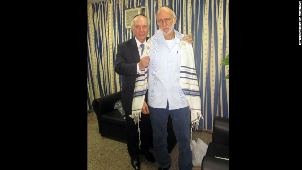 "Alan Gross, at right with Rabbi Arthur Schneier, was jailed while working as a subcontractor in Cuba in December 2009. Cuban authorities say Gross tried to set up illegal Internet connections on the island. Gross says he was just trying to help connect the Jewish community to the Internet. Former President Jimmy Carter and New Mexico Gov. Bill Richardson both traveled to Cuba on Gross' behalf. He was eventually <a href=""http://www.cnn.com/2014/12/17/politics/cuba-alan-gross-deal/index.html"" target=""_blank"">released in December</a>."