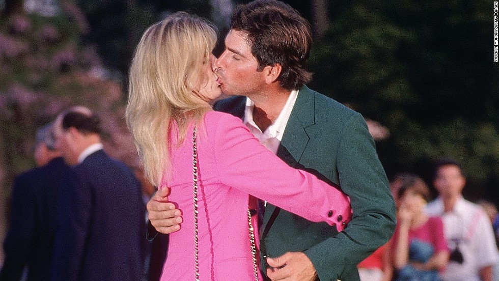 Sealed with a kiss. Fred Couples celebrates his one and only major success at the 1992 Masters with his wife Debbie.