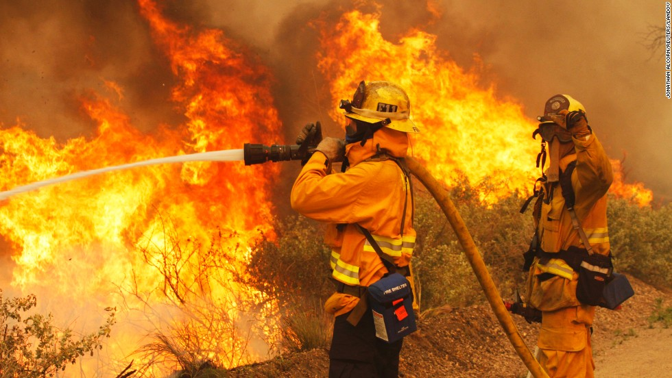 Firefighters battle a wildfire at Point Mugu State Park in California, on May 3.