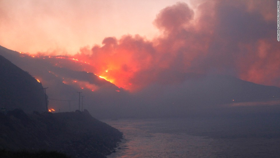 The Springs Fire burns in the early morning near the Pacific Coast Highway at Point Mugu State Park, California, on May 3.