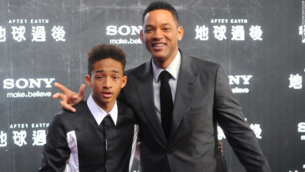 Will Smith and his son Jaden pose for photographers before a fan meeting in Taipei on May 3.