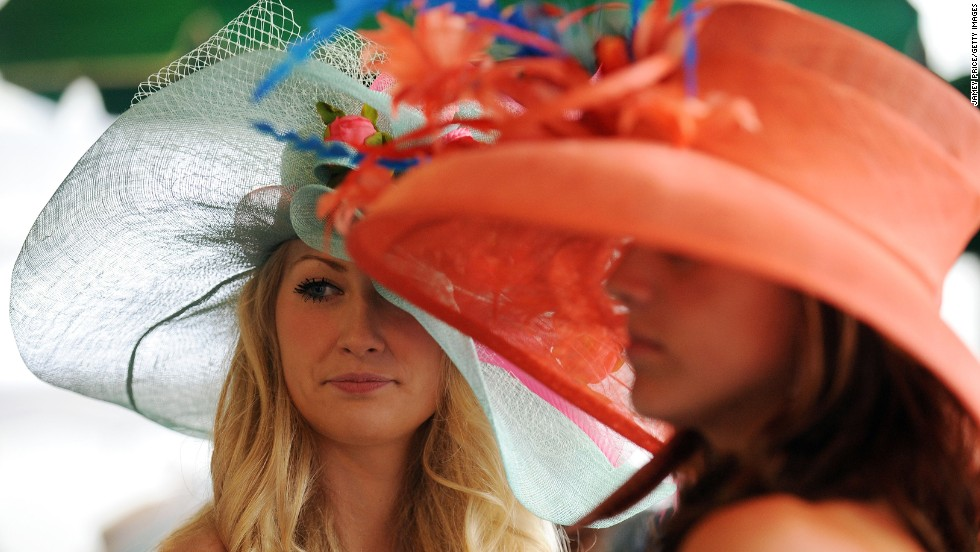 The gloomy weather did not deter many from wearing the vibrantly colored and stylish hats that are a hallmark of the event.