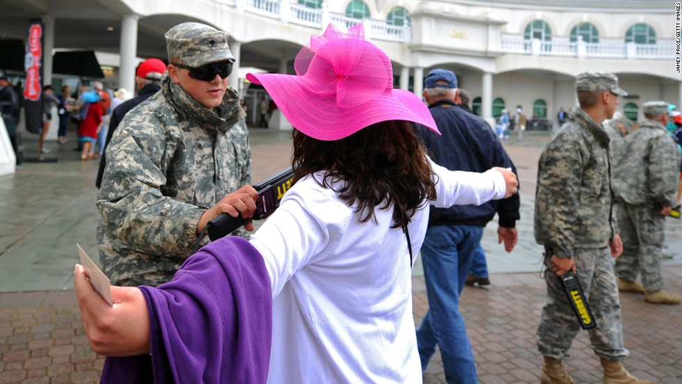 Security personnel check fans entering Churchill Downs. The Kentucky Derby is the largest U.S. sporting event since the April 15 bombings at the Boston Marathon.