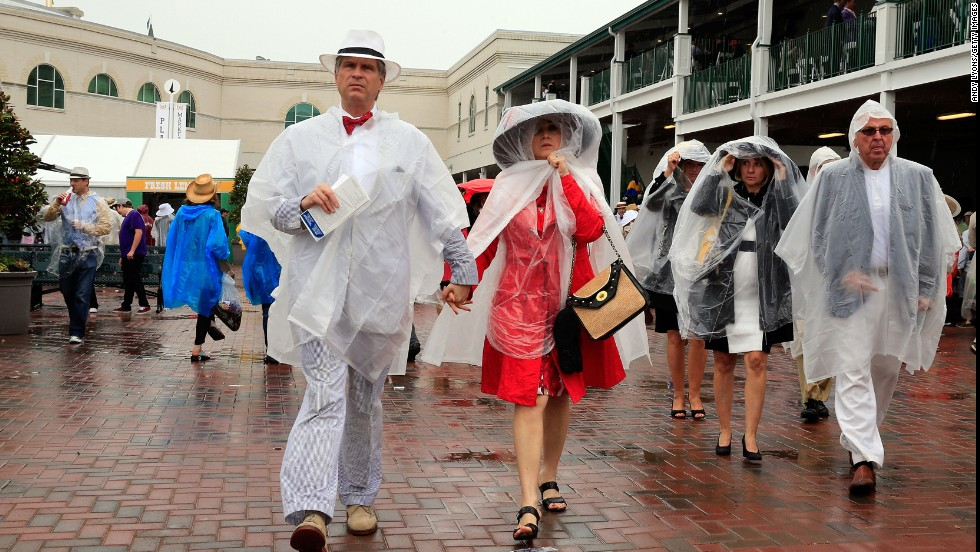 Plastic rain slickers mute the fashions of Derby attendees.