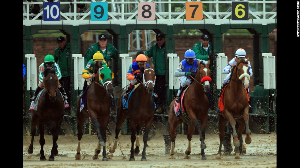 The horses burst through the gate at the start of the Kentucky Derby.