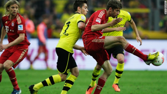 Bayern Munich's Thomas Mueller controls the ball during his side's 1-1 draw at Borussia Dortmund in the Bundesliga.