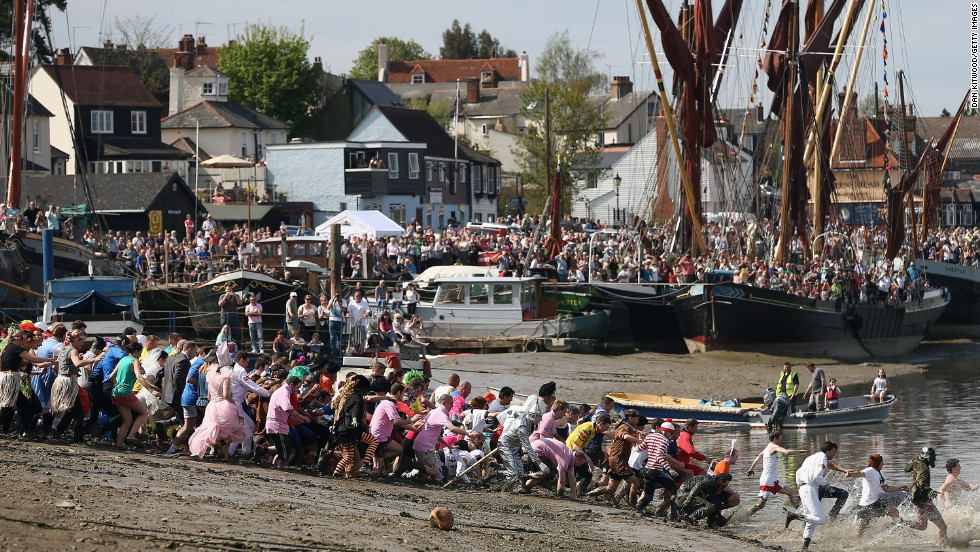 Revelers take part in the Maldon Mud Race at the start of the event on Sunday, May 5, in Essex, England. The race, which originated in 1973 and involves competitors racing around a course on the mud banks of the River Blackwater, raises money for charity.
