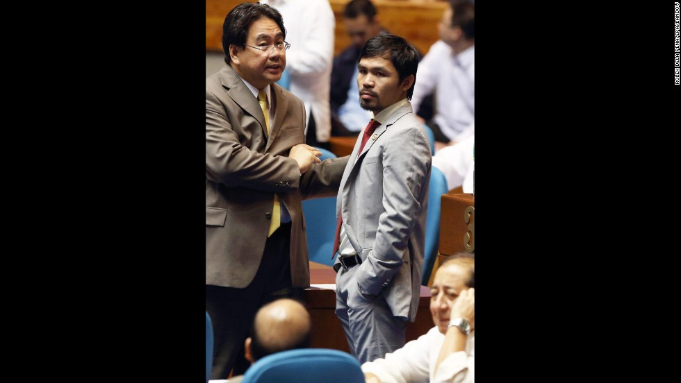 Pacquiao attends a plenary session discussing a proposed reproductive health bill at the House of Representatives at Congress in Quezon City, east of Manila, Philippines,  August 6, 2012.