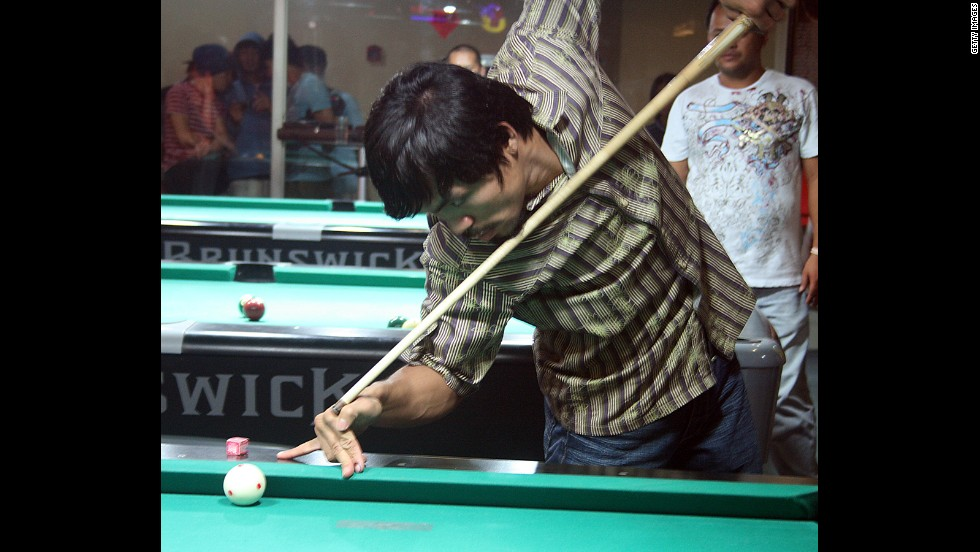 Pacquiao plays billiards at his recreational center in General Santos, Mindanao, in May 2010.