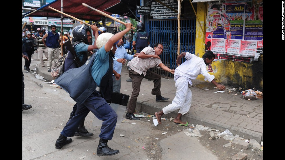 Bangladeshi police charge at Islamists with batons during clashes on May 5.