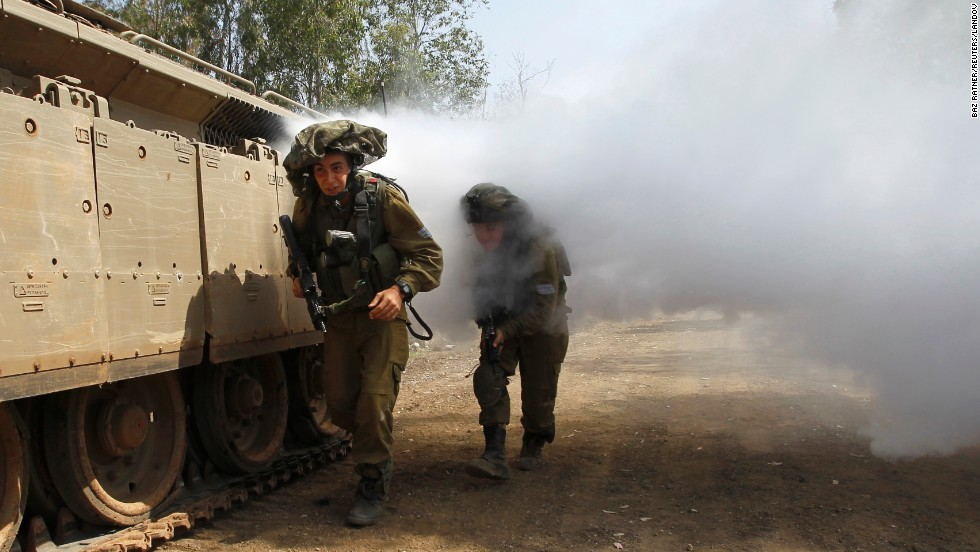 Israeli troops make their way through smoke during exercises in the Golan Heights on May 6.