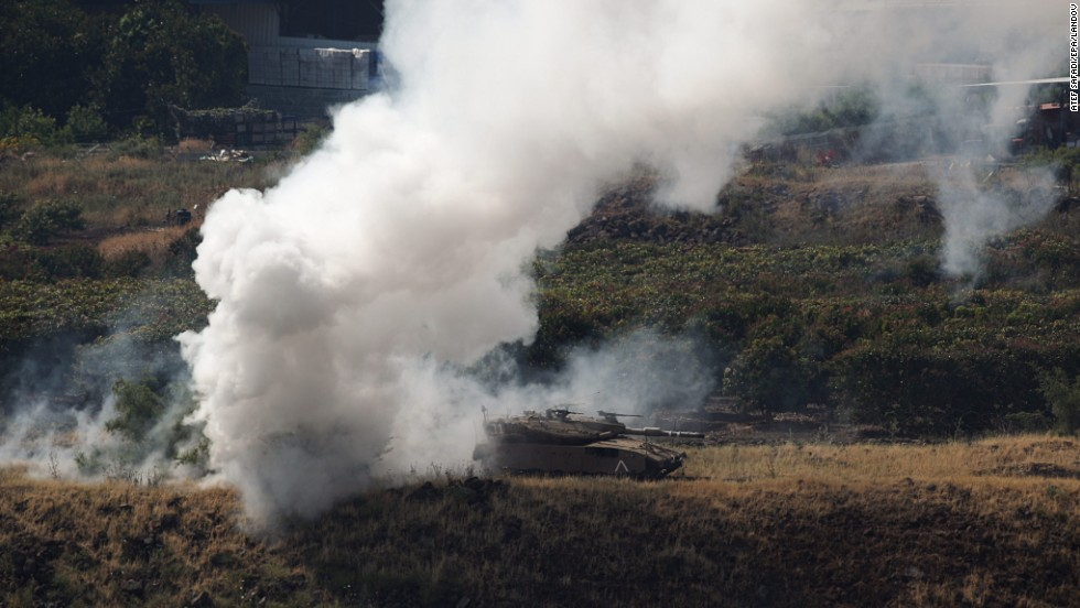 "Smoke billows behind an Israeli tank before a military exercise in the Golan Heights on April 23. <a href=""http://www.cnn.com/2012/07/16/middleeast/gallery/syria-unrest/index.html"">See the Syrian civil war in photos.</a>"