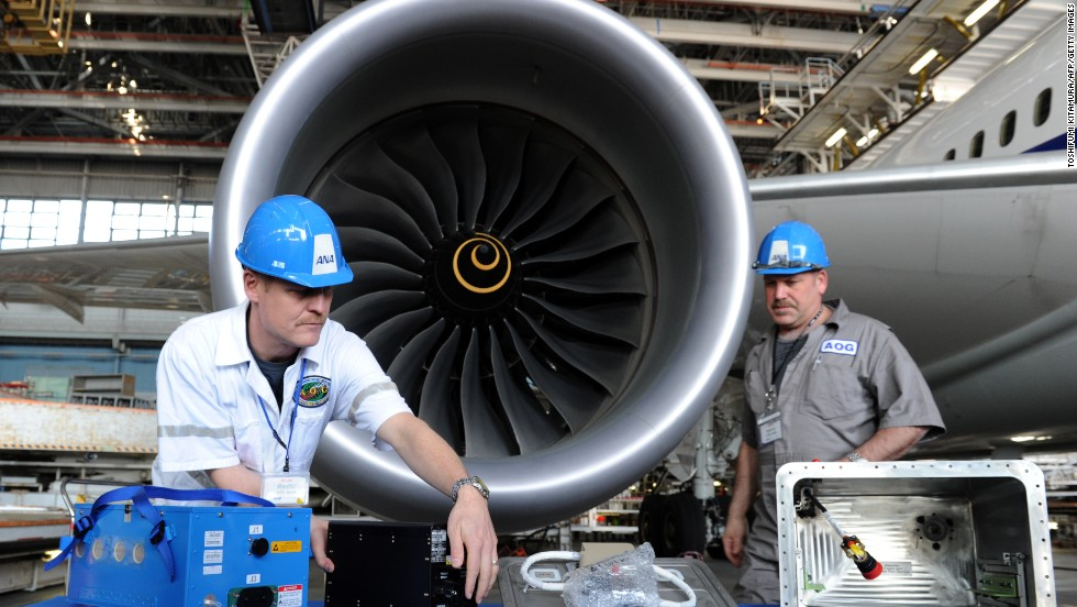 A January 2013 battery fire prompted the worldwide grounding of all Boeing 787 Dreamliners -- one of the most advanced, sophisticated airliners in the sky. Members of Boeing's Aircraft On Ground (AOG) team display components of the new Dreamliner battery system after an ANA 787 test flight. To implement the fix, Boeing moved a small army of technicians to 13 international locations. Click through the photos to see how Boeing re-engineered the battery to make it safer.
