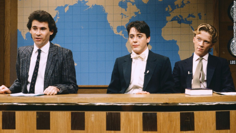 "Downey joined 'Saturday Night Live's"" cast for a season. From left, Dennis Miller, Downey and Anthony Michael Hall act out a ""Weekend Update"" on April 14, 1986."
