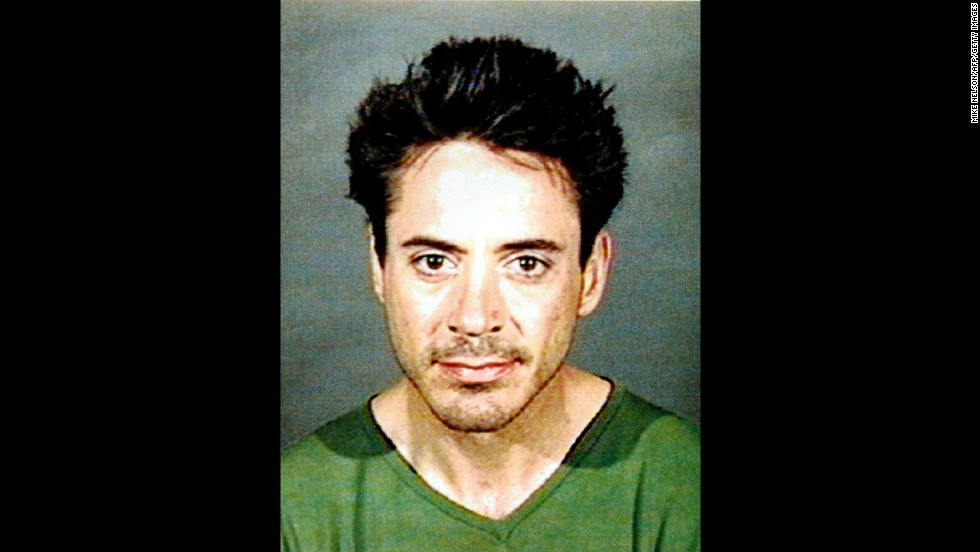 "Downey was arrested in Los Angeles on a misdemeanor charge of being under the influence of a controlled substance on April 24, 2001. Police found Downey wandering in an alley. ""Ally McBeal"" producer David E. Kelly let the actor go after the arrest. Prosecutors later said they would treat the incident as a violation of Downey's parole from a prior string of drug convictions and send the matter to state corrections officials."