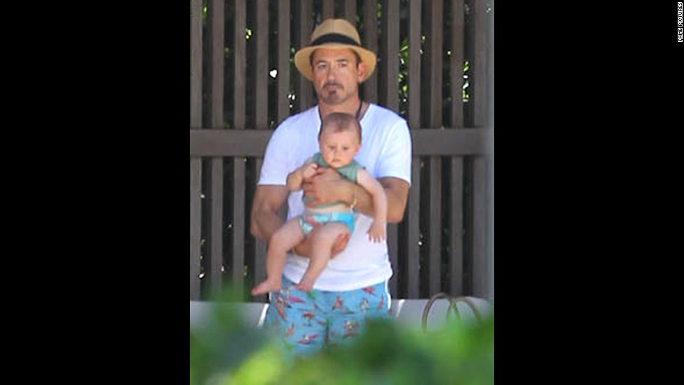 "In 2012, Downey and wife Susan became parents of a son, Exton. The 48-year-old's resilience, charm and talent have earned him a high-ranking spot in the box office with ""Iron Man 3,"" which had the second-best opening weekend, behind ""The Avengers' "" $207.4 million bow on this weekend a year ago. ""The Daily Show's"" Jon Stewart had a straight face when he told the actor ""You are Iron Man. You are."""