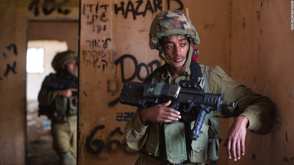 An Israeli soldier pauses during a military exercise at the Israeli-annexed Golan Heights on May 6.