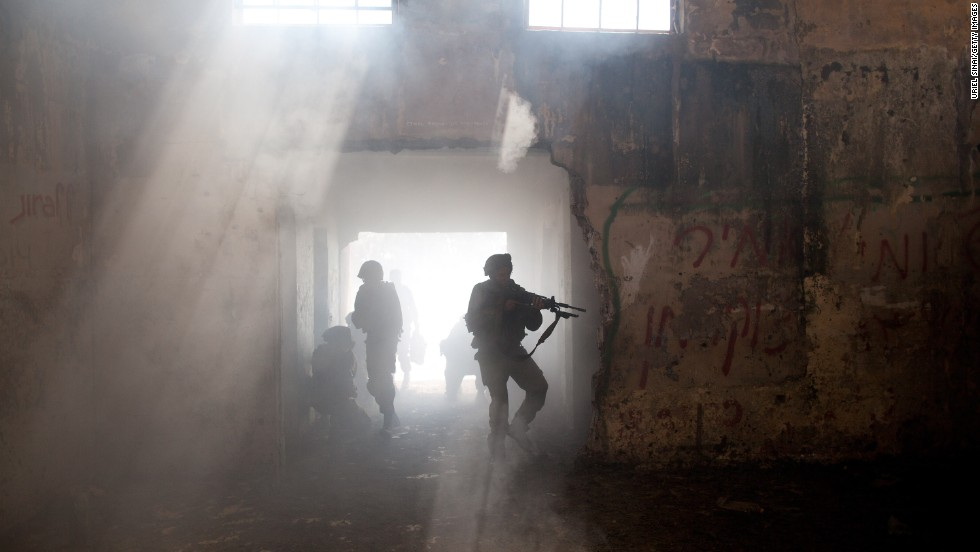 Israeli soldiers move through a dusty building during a military exercise on May 6.