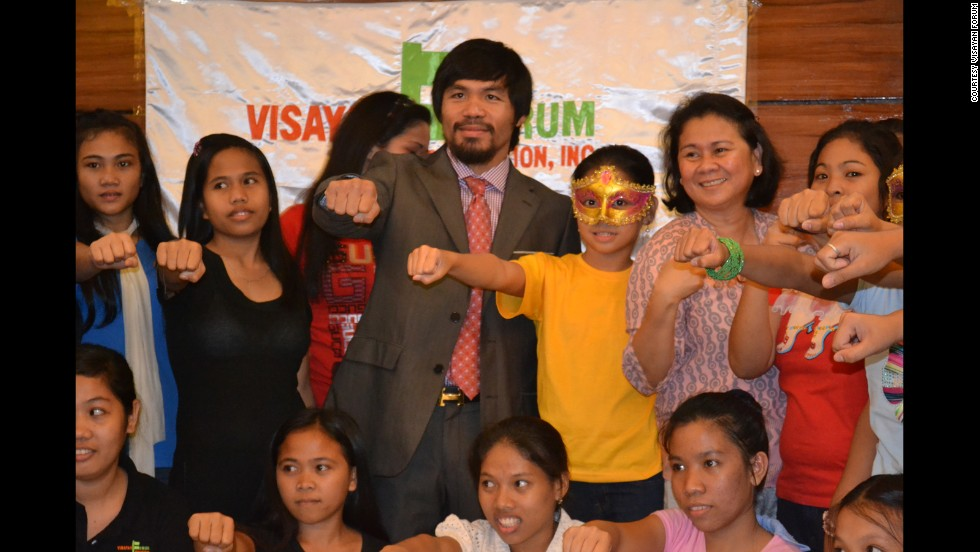 Manny Pacquaio, with Oebanda, meets girls rescued from human traffickers. The girls shared their stories with Pacquaio, who also spoke at congress in support of an anti-trafficking law.