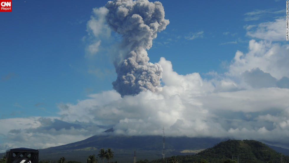 "Filipino <a href=""http://ireport.cnn.com/people/Recamunda"">iReporter Recamunda </a>lives less than two kilometers from the volatile Mount Mayon volcano, which spewed ash and rocks early Tuesday, killing five climbers. When he saw smoke and ash belching from the volcano, one of the most active in the Philippines, he grabbed his camera and took these shots. ""I live very close but we're used to eruptions,"" he says, ""we're only affected by the ash cloud""."