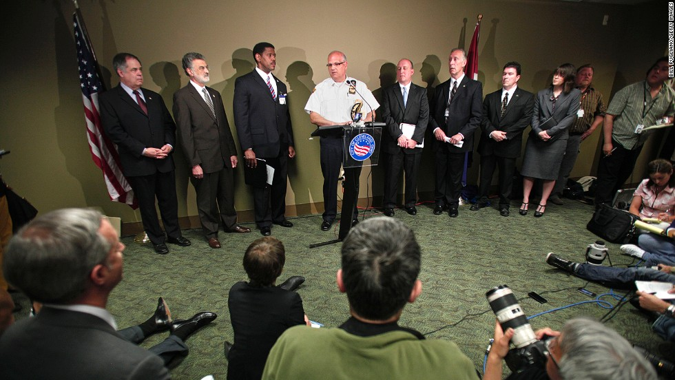 Cleveland Deputy Chief of Police Ed Tomba, center, speaks at a news conference to address details of the developments.