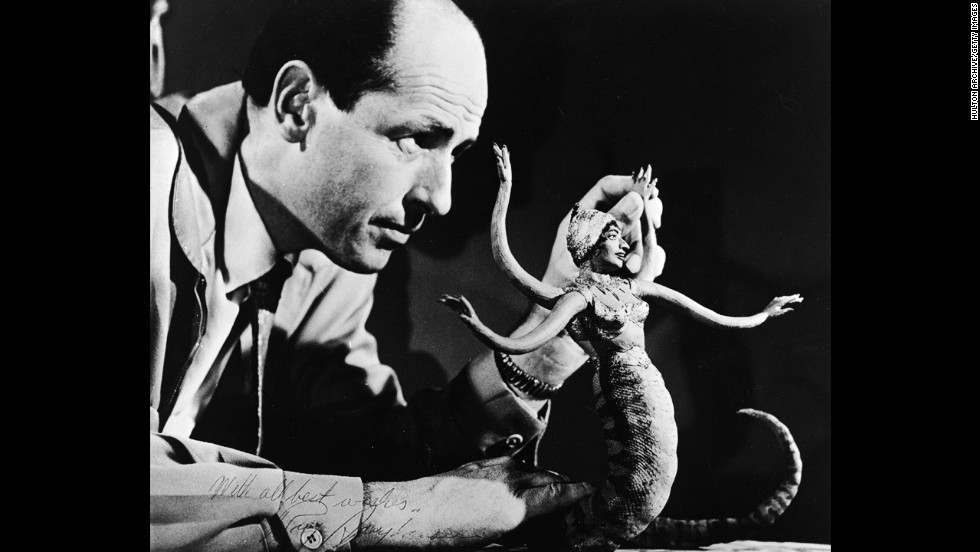 Harryhausen manipulates a figure of a serpent-like monster for a stop-motion animation scene, circa 1965.