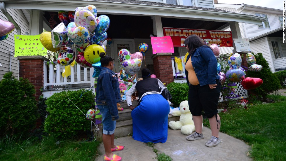 Well-wishers visit the home of the sister of Amanda Berry on Monday, May 6.