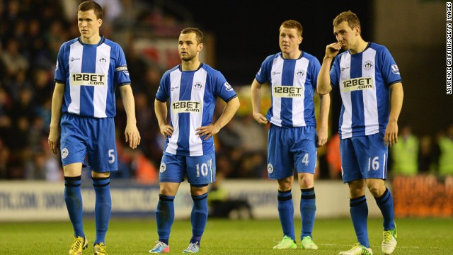 Wigan's players stand dejected after conceding against Swansea in a game they lost 3-2
