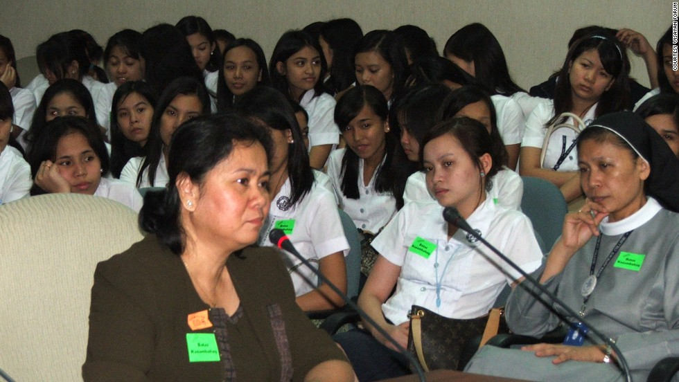 Oebanda speaks before the Philippine Senate during deliberations about the Magna Carta on Domestic Workers in 2002. The legislation was designed to improve conditions for domestic workers in the country.