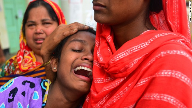 A Bangladeshi relative reacts after identifying the body of her father killed in last week's building collapse in Savar, on May 7, 2013.