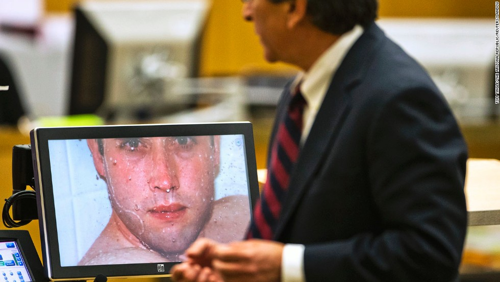On February 28, prosecutor Juan Martinez asks Arias about a photograph she took of Alexander in the shower moments before he was killed.