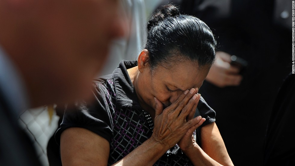 Ada Colon prays during a vigil held in honor of the kidnapping victims in Cleveland on Wednesday, May 8.
